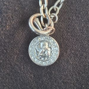 Silver coin necklace with angel